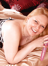 Anilos Tamara in pantyhose shows off her pussy and fucks it with her amazing pink toy