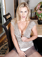 Big titted Tanya Tate slips off her evening wear and fingers her shaved Anilos pussy until she gets off