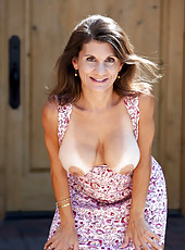Naughty milf Tori Baker shows off her big natural breasts and pussy outside