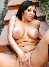 Voluptuous naughty Anilos woman penetrates her shaved pussy with a pink vibrator outdoors
