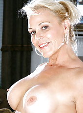 Blonde cougar Veronica flaunts her mature nude body and her huge boobs