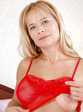 Pretty blonde Anilos Viktoria shows off her tight ass and bountiful breasts in skimpy lingerie