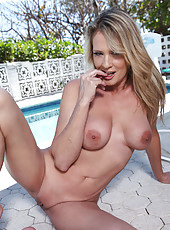 Blonde cougar Bridgette Lee peels off her bikini and exposes her milf breasts and pussy outdoors