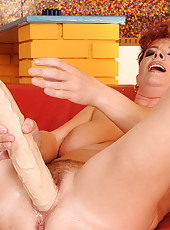 Hairy old cunt fucked w huge dildo and fisted