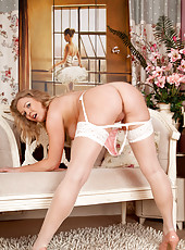 Elegant milf in heels and stockings strips off her lace lingerie to tease her pussy