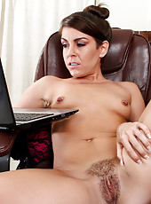 Office secretary masturbates as shes watch Anilos porn on her laptop