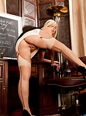 Miss Anna Joy is a teacher who loves to masturbate on top of her desk