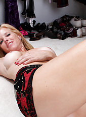 Classy MILF next door Georgie tries on dress without undies and spreads on the floor