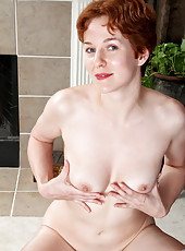 Anilos nymph Gigi strips naked and uses anal beads to pleasure her juicy pussy