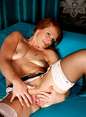Redhead Kay C strips for us to see her perky tits and wet pussy