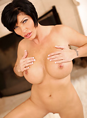 Bosomy Anilos Shay Fox set the fireplace on fire with her naked milf body