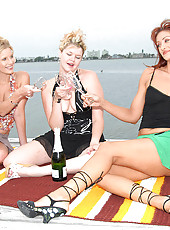 These 3 hot milfs are drinking champaign out on the dock and gettin frisky in these hot pics