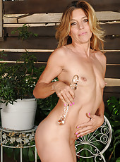 Monique strips and stabs at her 51 year old pussy with her glass toy