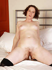 39 year old MILF Artemesia slips her glass dildo deep into her pussy