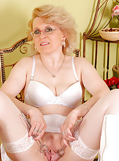 43 year old MILF Margeaux in white lace plays with her meaty pussy