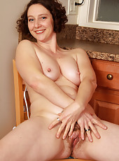 New mature model Artemesia showing off her furry pussy and pits