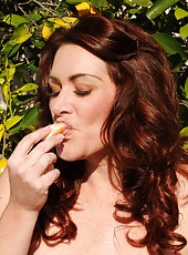 Gorgeous long haired and big boned Ryan tastes a piece of fruit