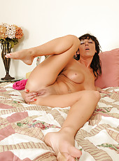 Horny 37 year old Coral strips and stuffs her fingers deep in her box