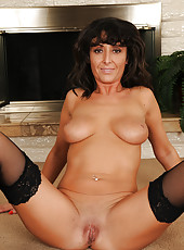 Coral flexes her firm MILF ass showing off her long legs in black stockings