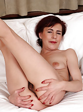 Horny Kate T slips off her black lingerie and spreads her furry box