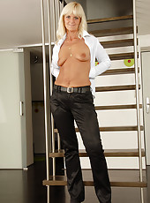 Blonde MILF Jenny F from AllOver30 strips and spreads on the stairs