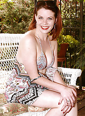 31 year old and redheaded Lilla Katt fooling around in the backyard