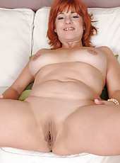 52 year old Calliste from AllOver30 showing off her body in slinky lingerie