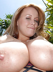 This super hot babe loves showing off those fine enourmous titties