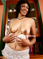 Elegant and exotic Issabella spreads her mature and hairy pussy