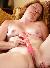 Cute 42 year old blonde Stacie totally enjoy her vibrator on the couch