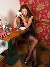 Sexy 41 year old and elegant Marlyn enjoying a spoon with her coffee