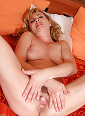 Horny and hairy Liz M from AllOver30 spreading wide in this series