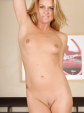 36 year old Amanda B slips off her clothes and has fun on the bed