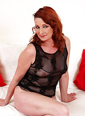45 year old Gigi slips off her sexy black lingerie and spreads her pink lips