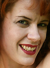 Redheaded MILF Megan from AllOver30 gets naked in the backyard