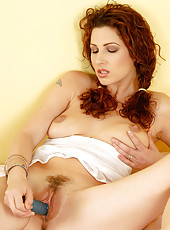 32 year old Yvete from AllOver30 slips a big dildo into her mature pussy