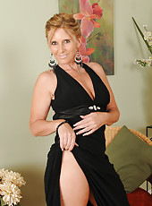Horny and elegant 46 year old Amanda Jean strips for our friends