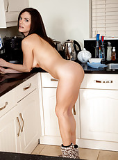 After cleaning the kitchen Rebekah likes to show off her tidy pussy