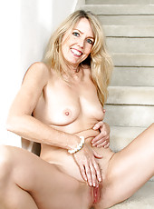 Blonde MILF Ginger B spreads her ass wide for you on the stairs