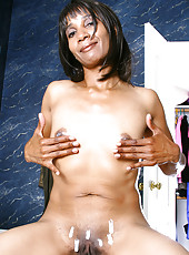 Ebony MILF Sara rubs cream all over her shaven mature pussy