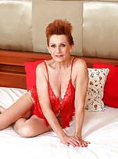58 year old Lucy O from AllOver30 crams her mature pussy with her toy