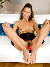 Hot 51 year old India F crams her mature pussy with pink plastic
