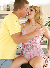 Blonde MILF lets the young stud force himself deep inside of her