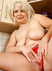 Sexy 50 year old Czech granny shows off her kitchen skills nude