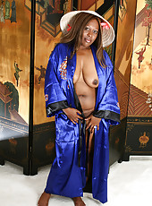 Ebony MILF from AllOver30 plays asian dress up for the camera