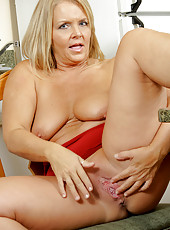 Hot and busty BBW showing off her pussy and ass in the kitchen