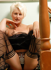 Blonde MILF Sally T struts on the stairs in black lingerie