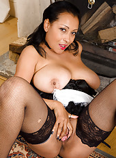 Busty and mature maid Danica plays after dusting the furniture