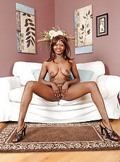 Black beauty Tori Torrel slides out of her gown and spreads wide open