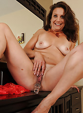 43 year old Chane from AllOver30 plugs her pussy with a glass dildo